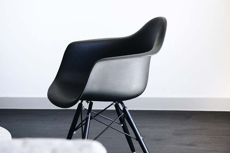 Modern black chair in minimalist room